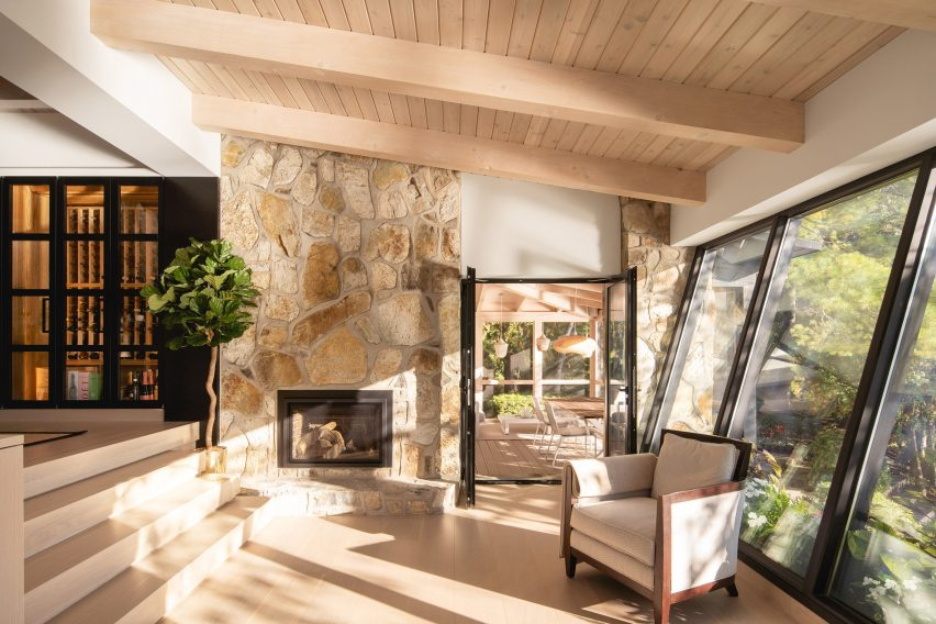 Stone fireplace in lakeside cottage in Canada