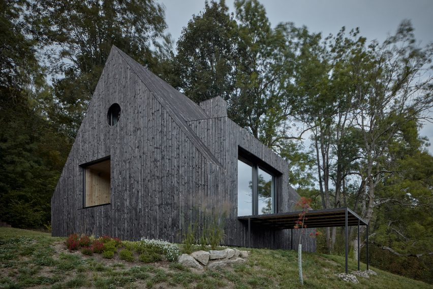 Charred-wood building on stilts