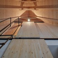 Pale wood lines the interior
