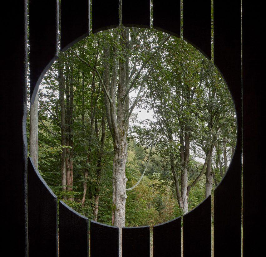 Circular window in wooden house