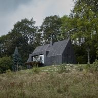 Cottage sits amongst trees