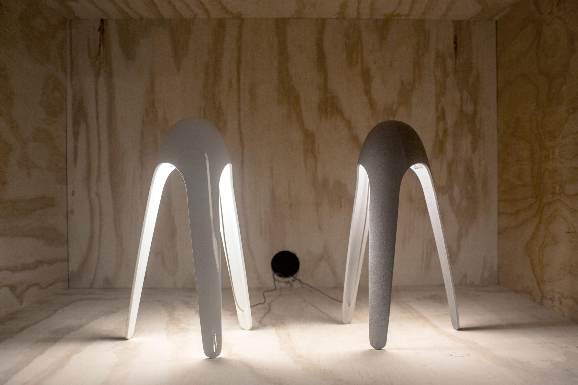 Two white Cyborg lamps by Karim Rashid
