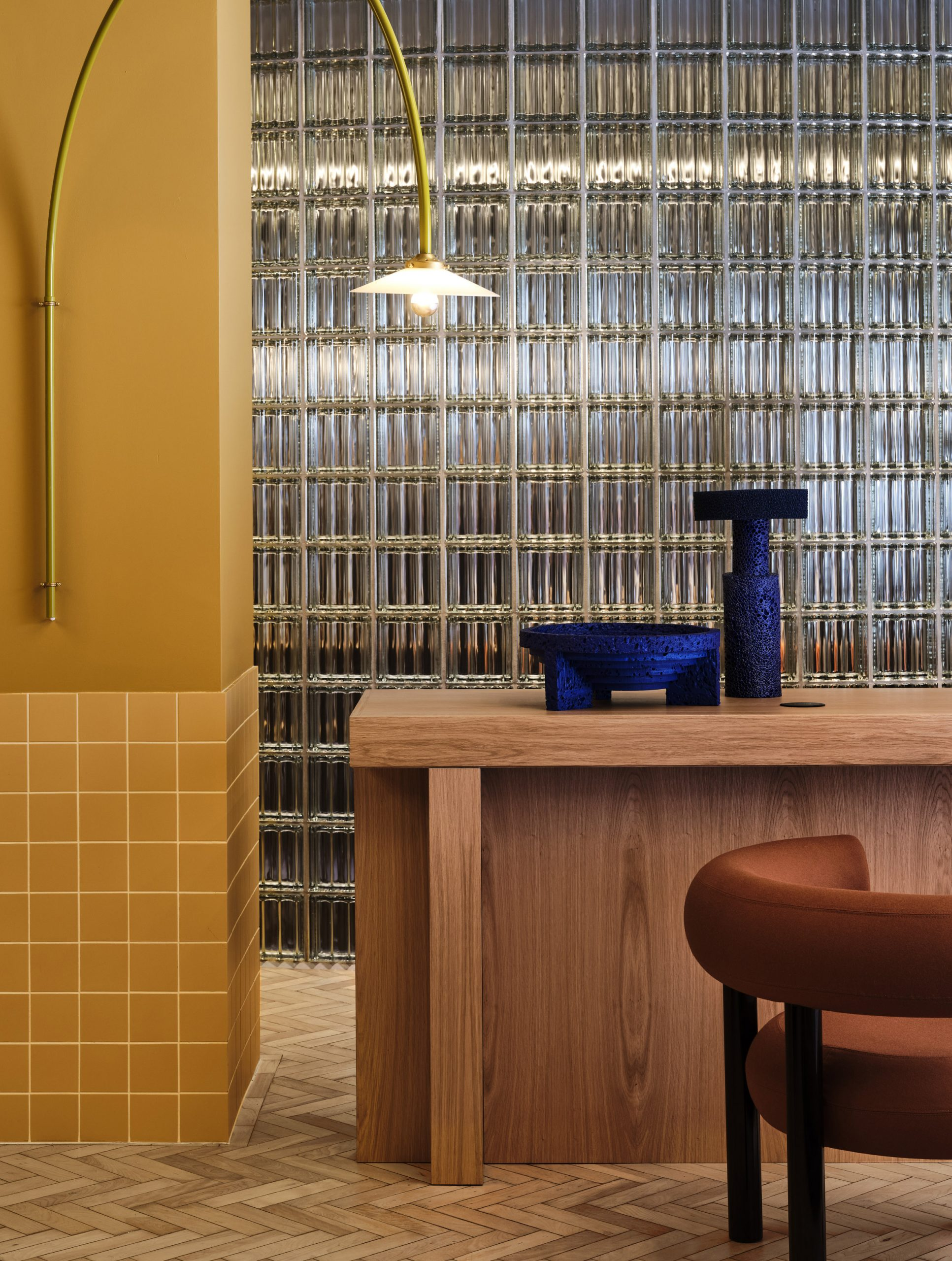 Glass block wall and yellow ceramic tiles in Douglas House