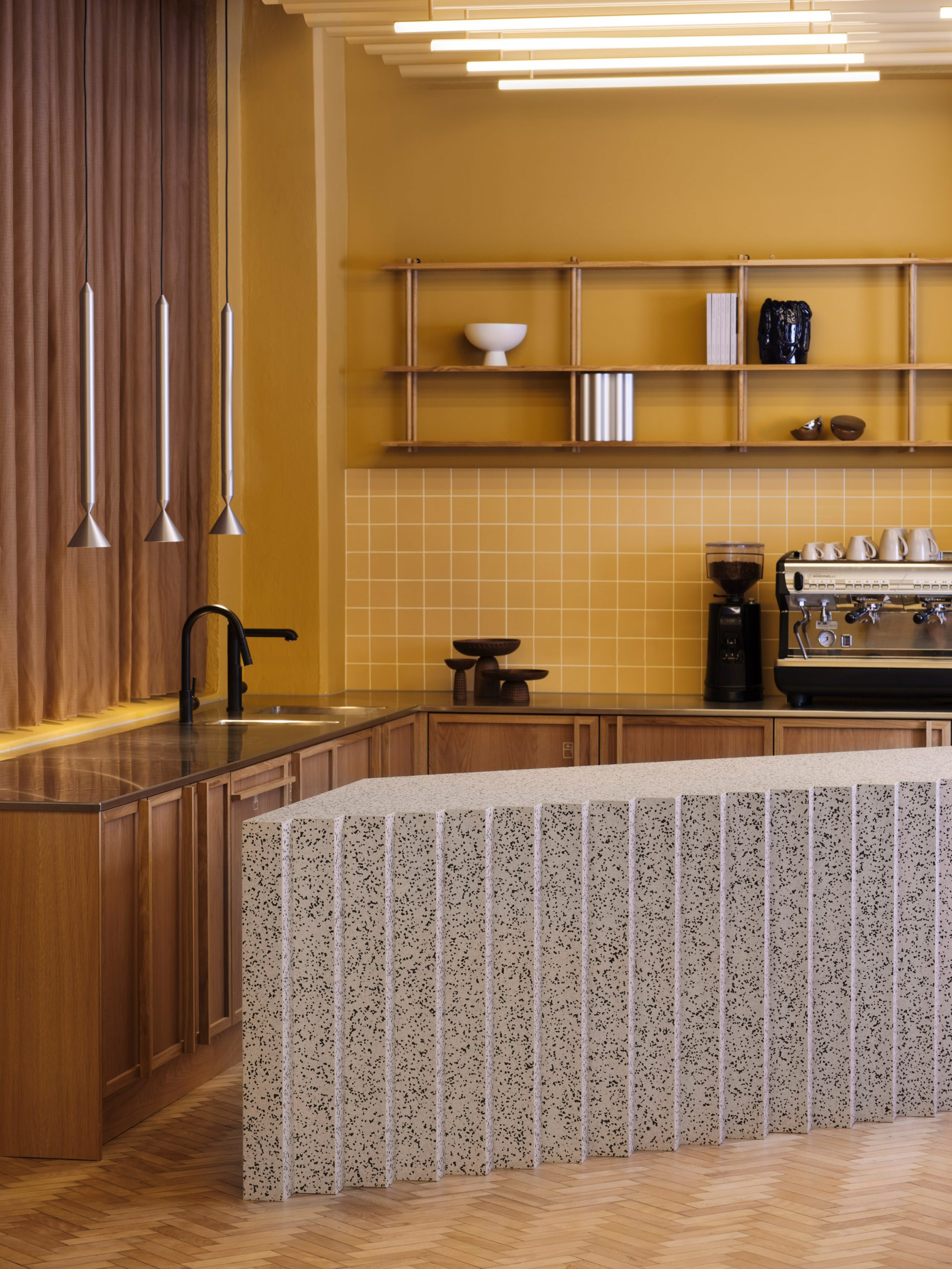Yellow ceramic tiles and grey counter