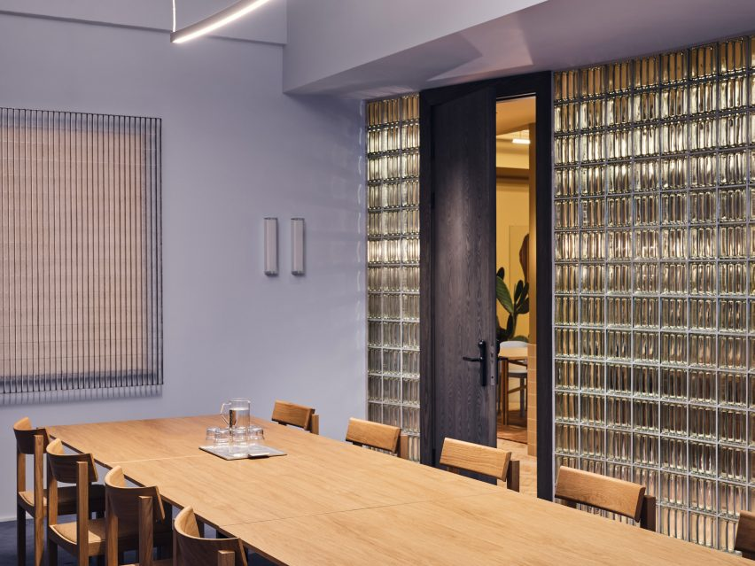 Blue meeting room with glass wall