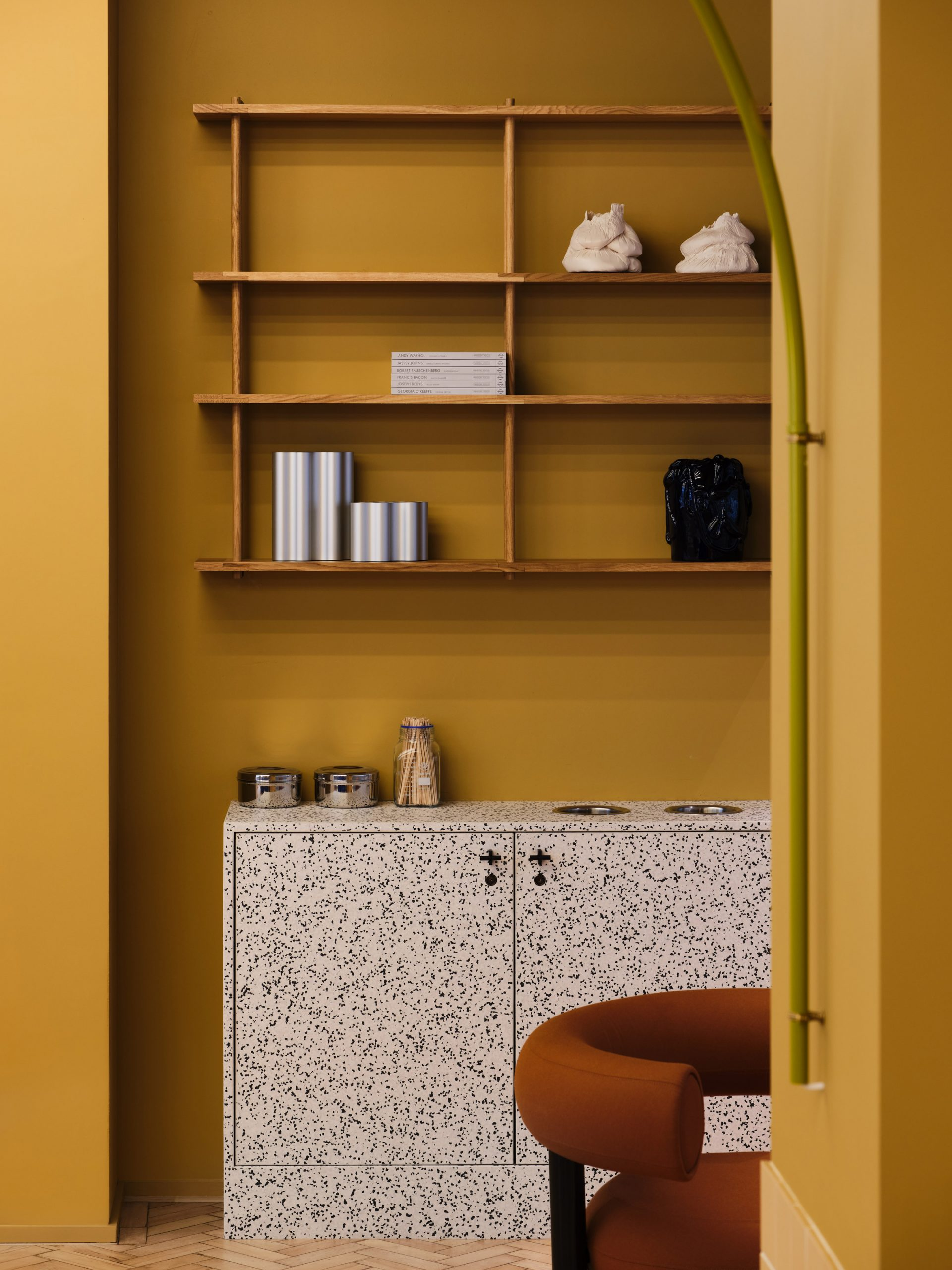 Yellow room with terrazzo furniture in Douglas House