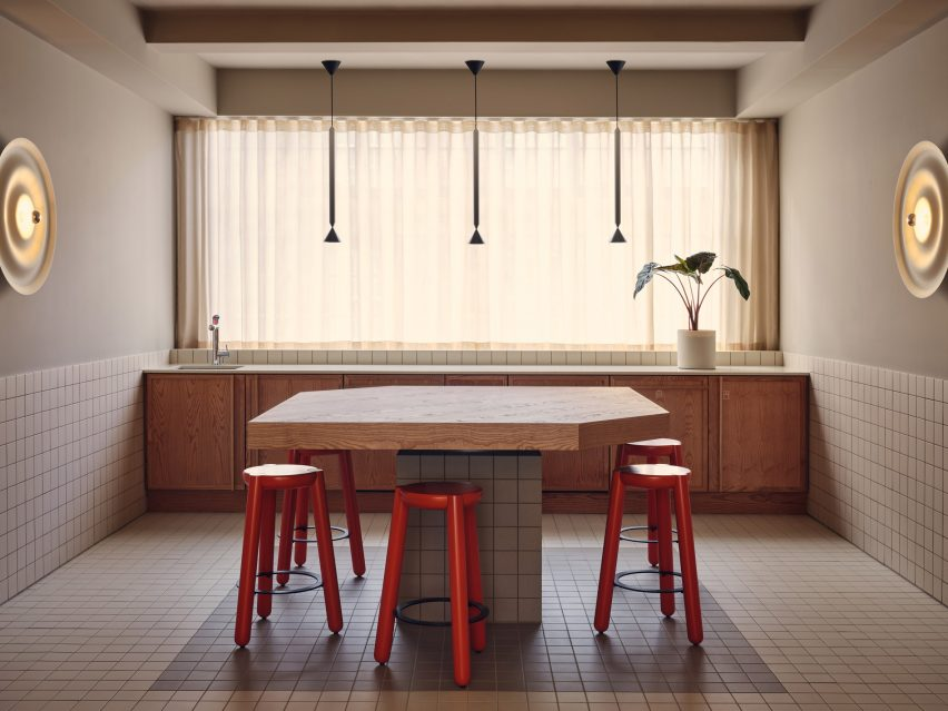 Durable materials and red chairs in Douglas House