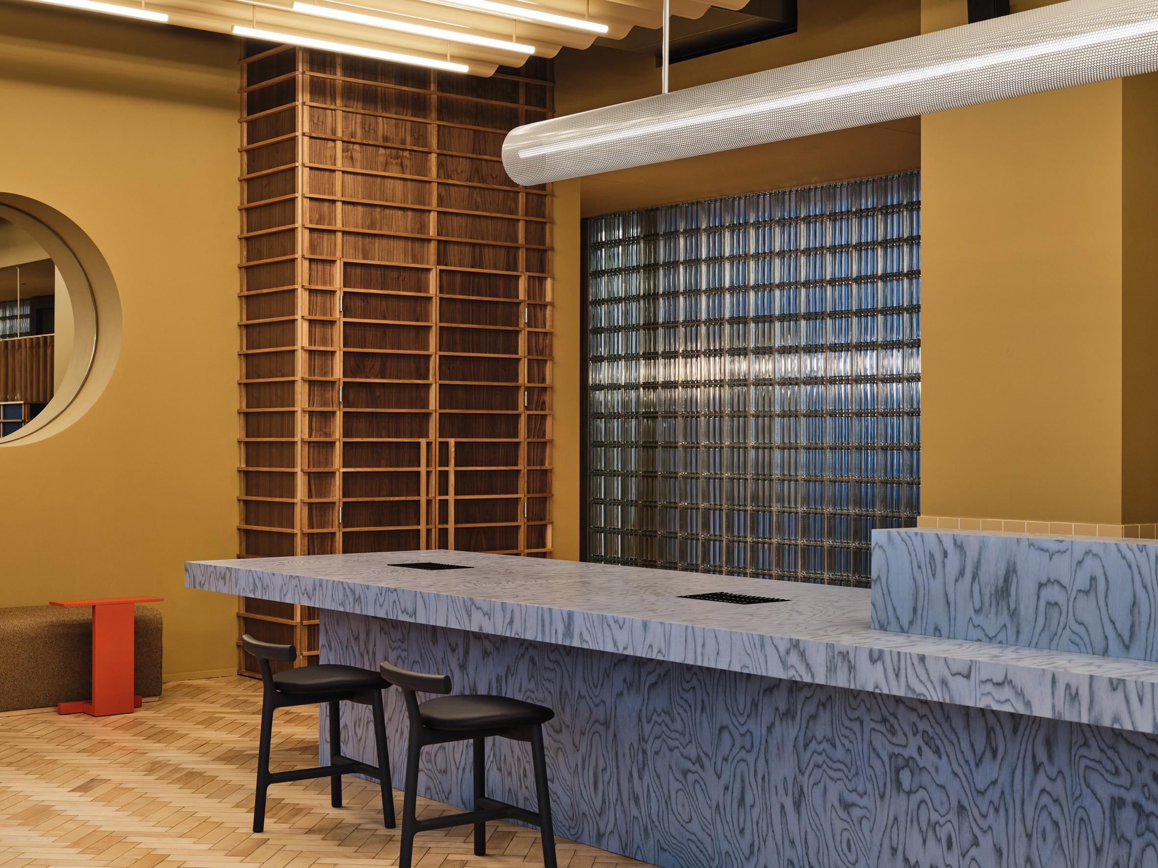 Reception desk clad in Ettore Sottsass Alpi veneer in blue