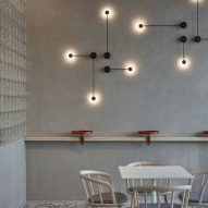 Concrete-style wall with metal lamps