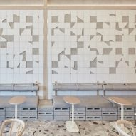 Roar Studio decorates Dubai cafe with terrazzo flooring and broken ceramic tiles