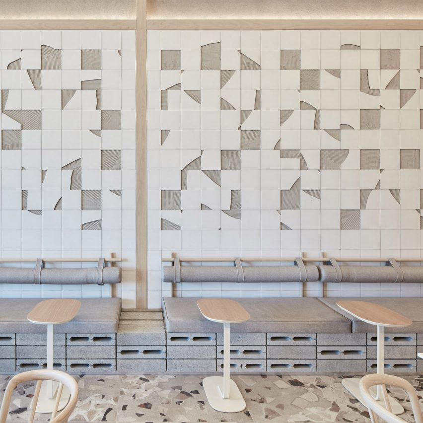 White ceramic mosaic and grey terrazzo floor in cafe
