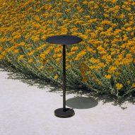 A black outdoor floor lamp by Marset