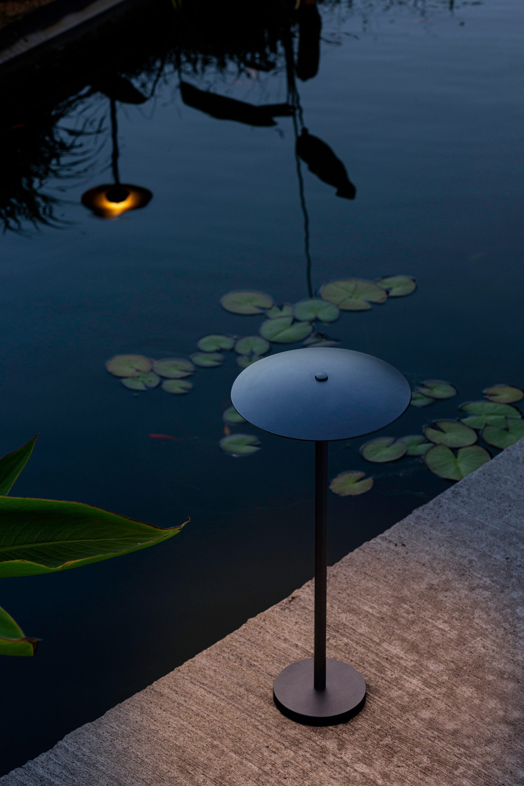 A black outdoor floor lamp by Marset