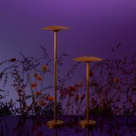 Two outdoor lamps by Marset with a warm rust-brown finish