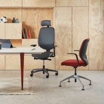 Giroflex 353 swivel chair and conference chair in an office
