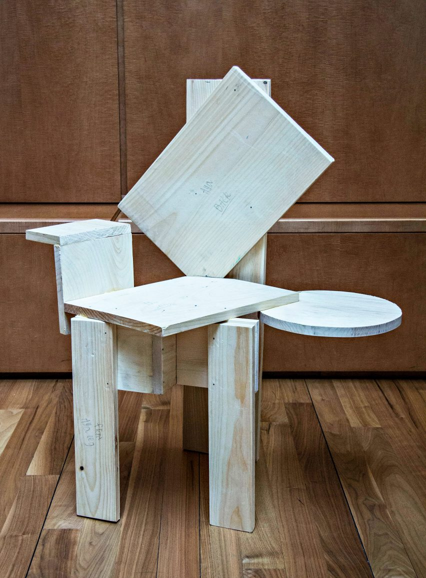 Unpainted, asymmetrical chair from Grade Three Chairs project by Bruce Edelstein at Trinity School
