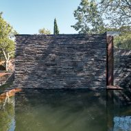 The slate exterior of a meditation room by Nicholas Burns
