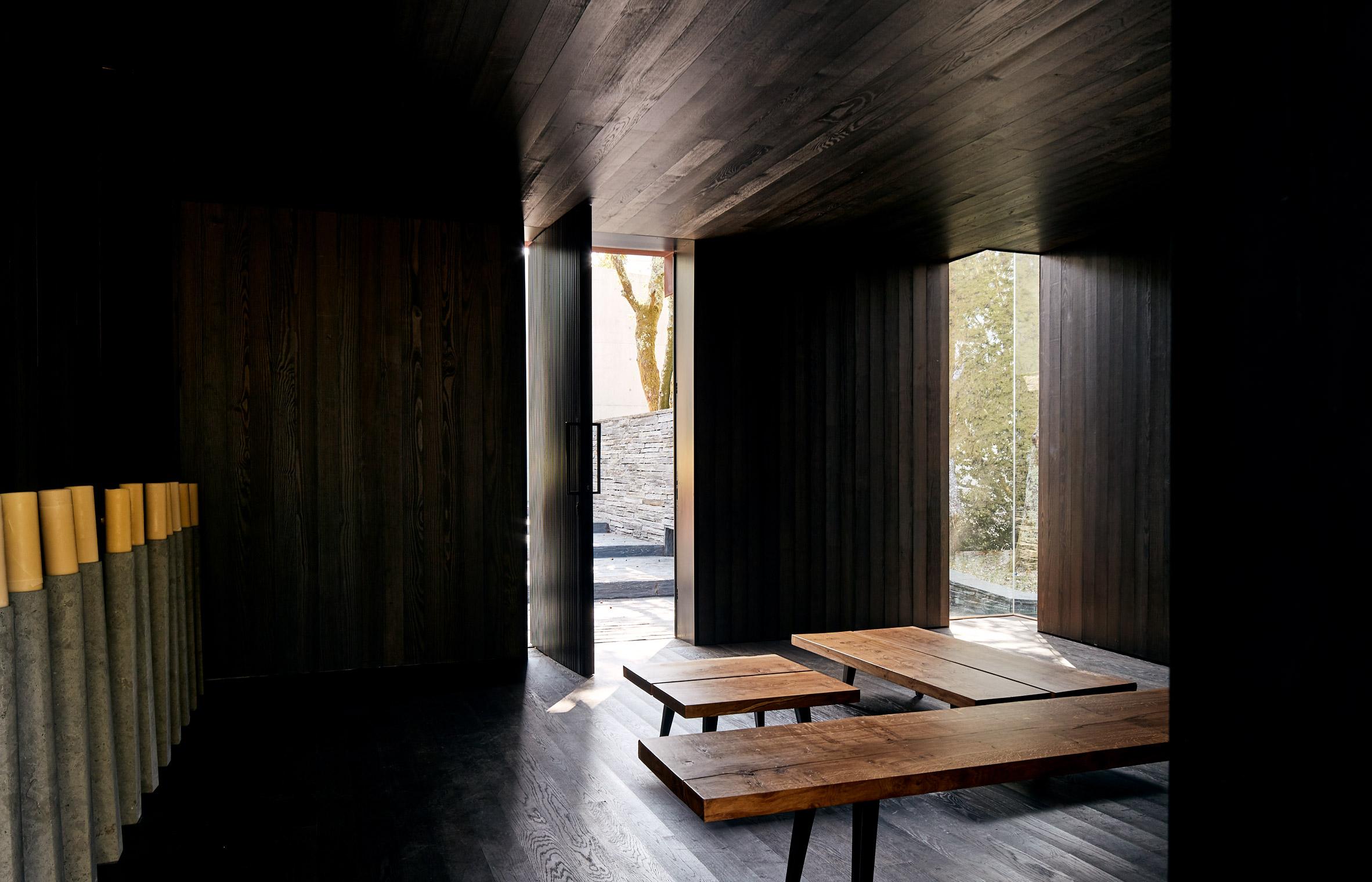 A dark-wood lined meditation room