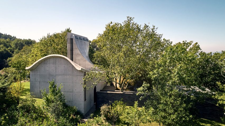 A concrete chapel hidden within amongst trees