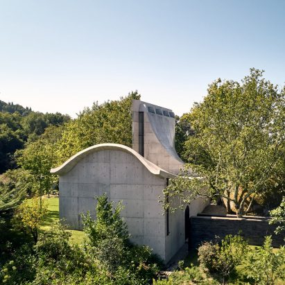 A concrete chapel on a hill in Portugal