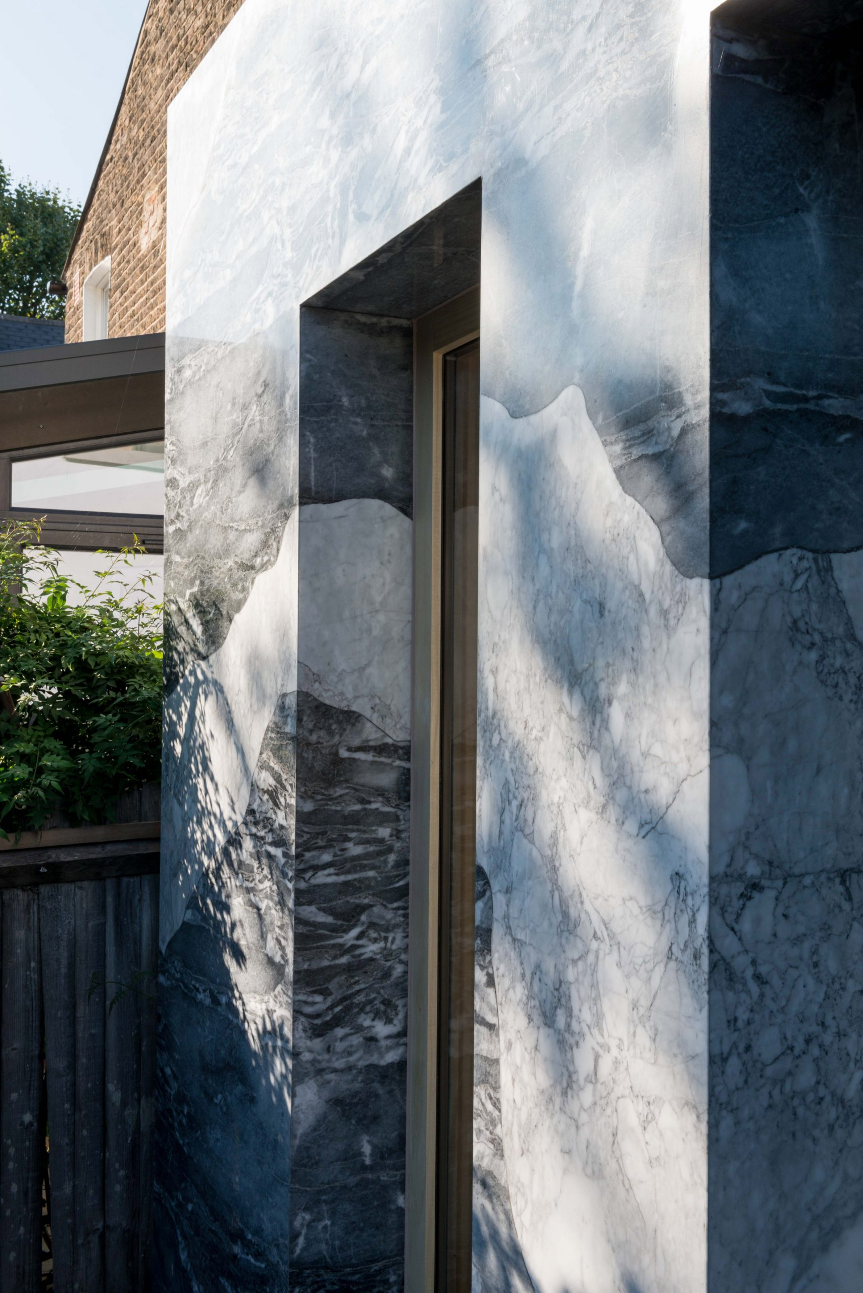 Marble-clad facade of extension of Hansler Road house extension by Alexander Owen Architecture