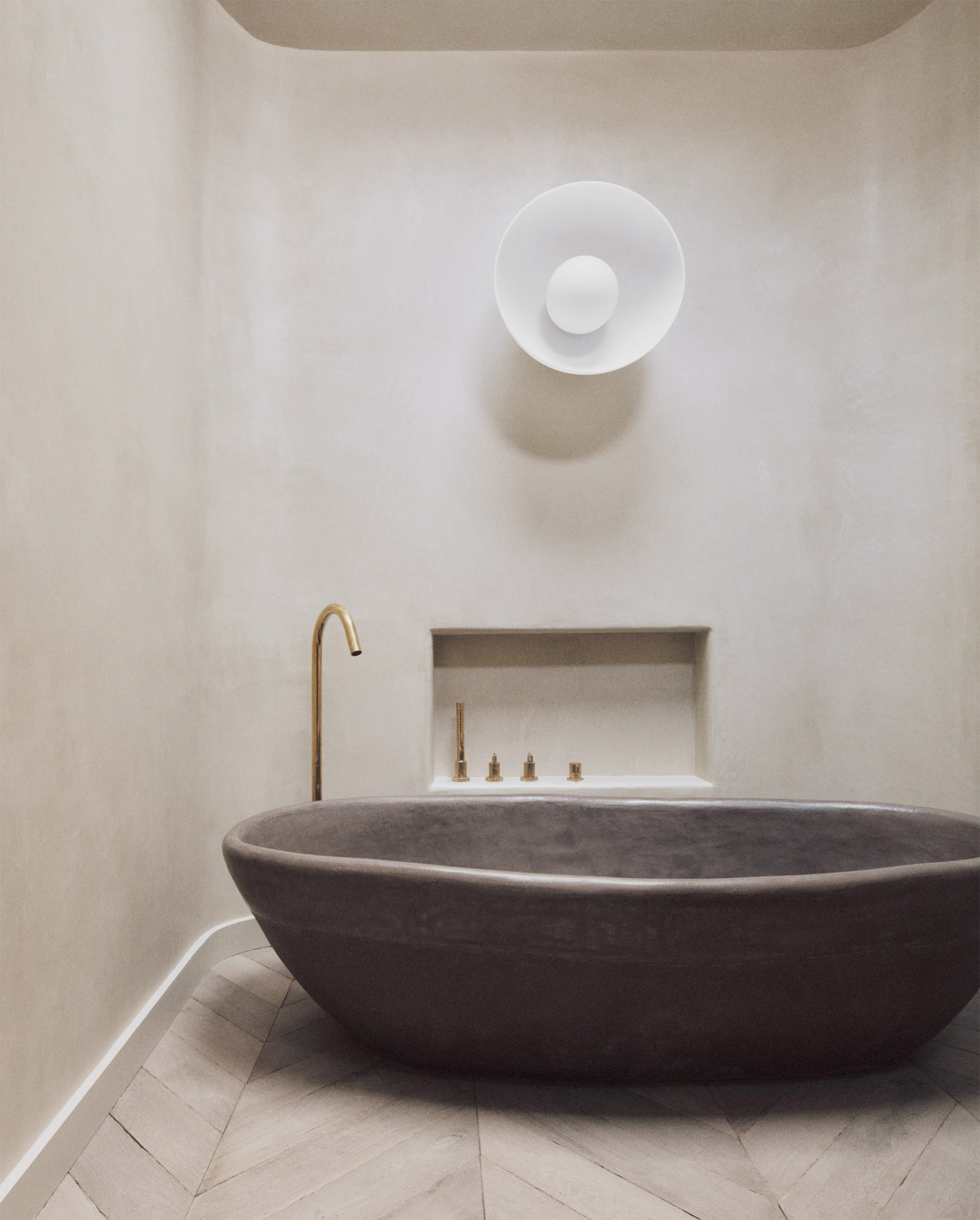 Bath made from sands, unfired clays, pigments and minerals