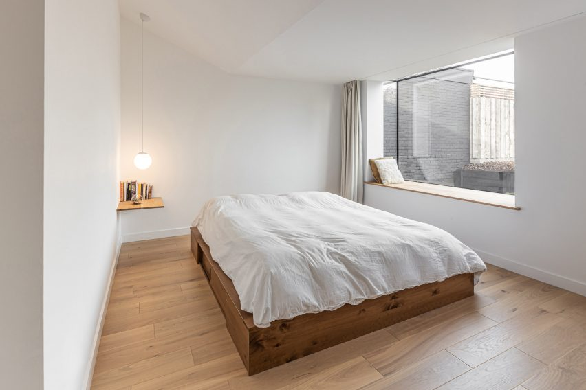 Master bedroom in Honey and Walnut House by Intervention Architecture