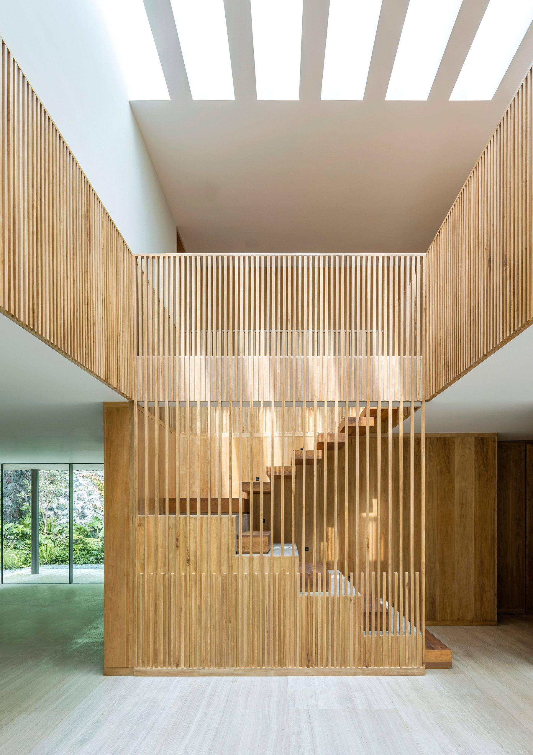 Wooden staircase in house renovation by Viga Arquitectos