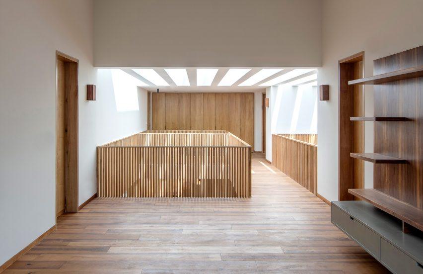 Oak wood floors and white walls