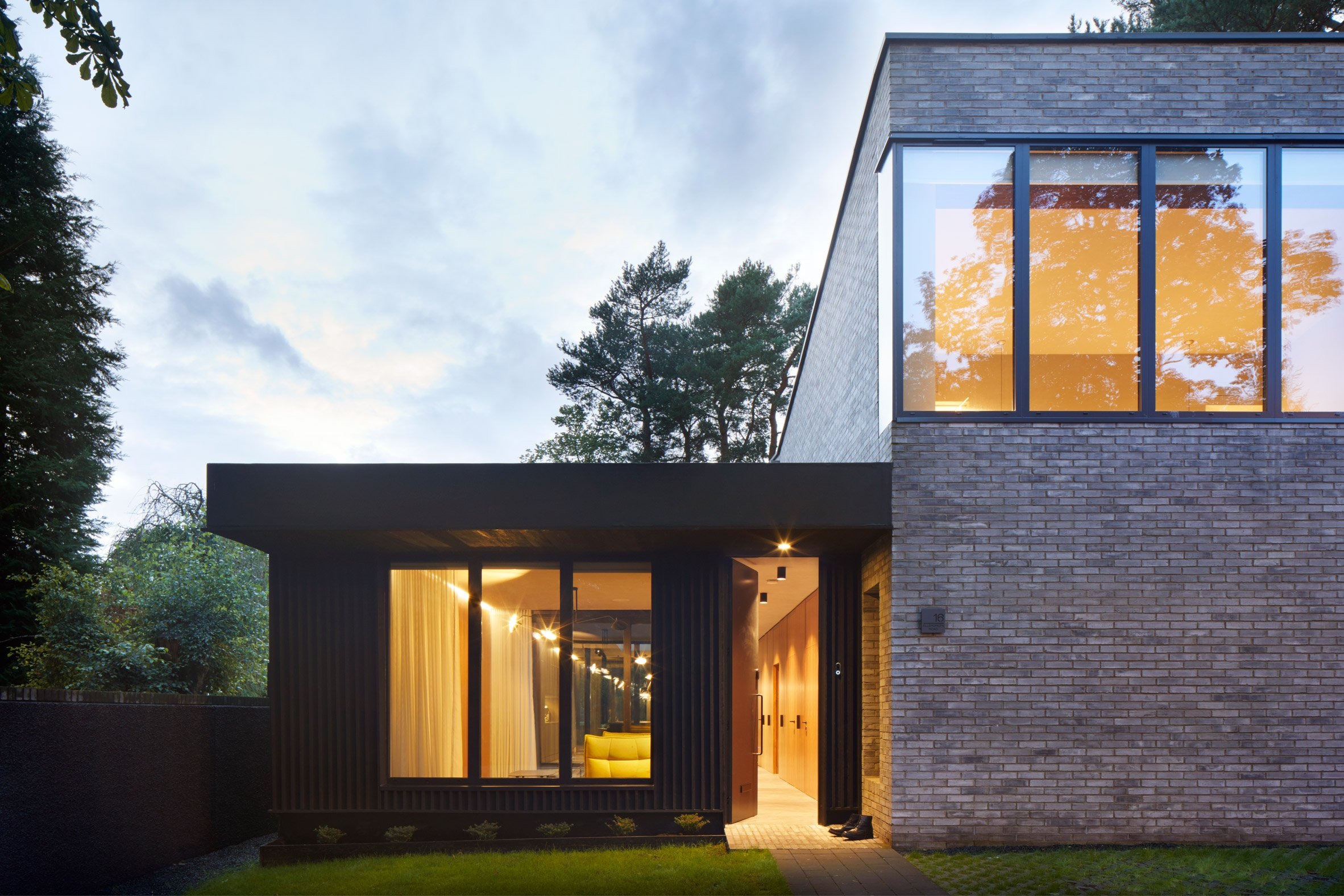 The brick and timber exterior of a house in Glasgow by McGinlay Bell