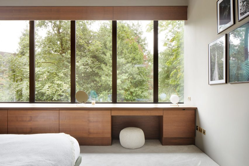 Walnut joinery within a white-walled bedroom in a Scottish house