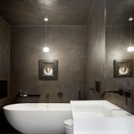 A dark bathroom within the House in Bearsden by McGinlay Bell