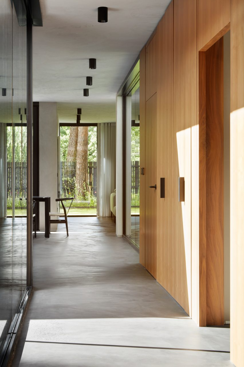 A wood and polished-concrete lined corridor of a Scottish house
