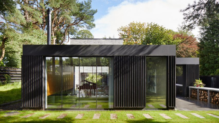 A timber-lined pavilion that forms part of a Scottish house by McGinlay Bell