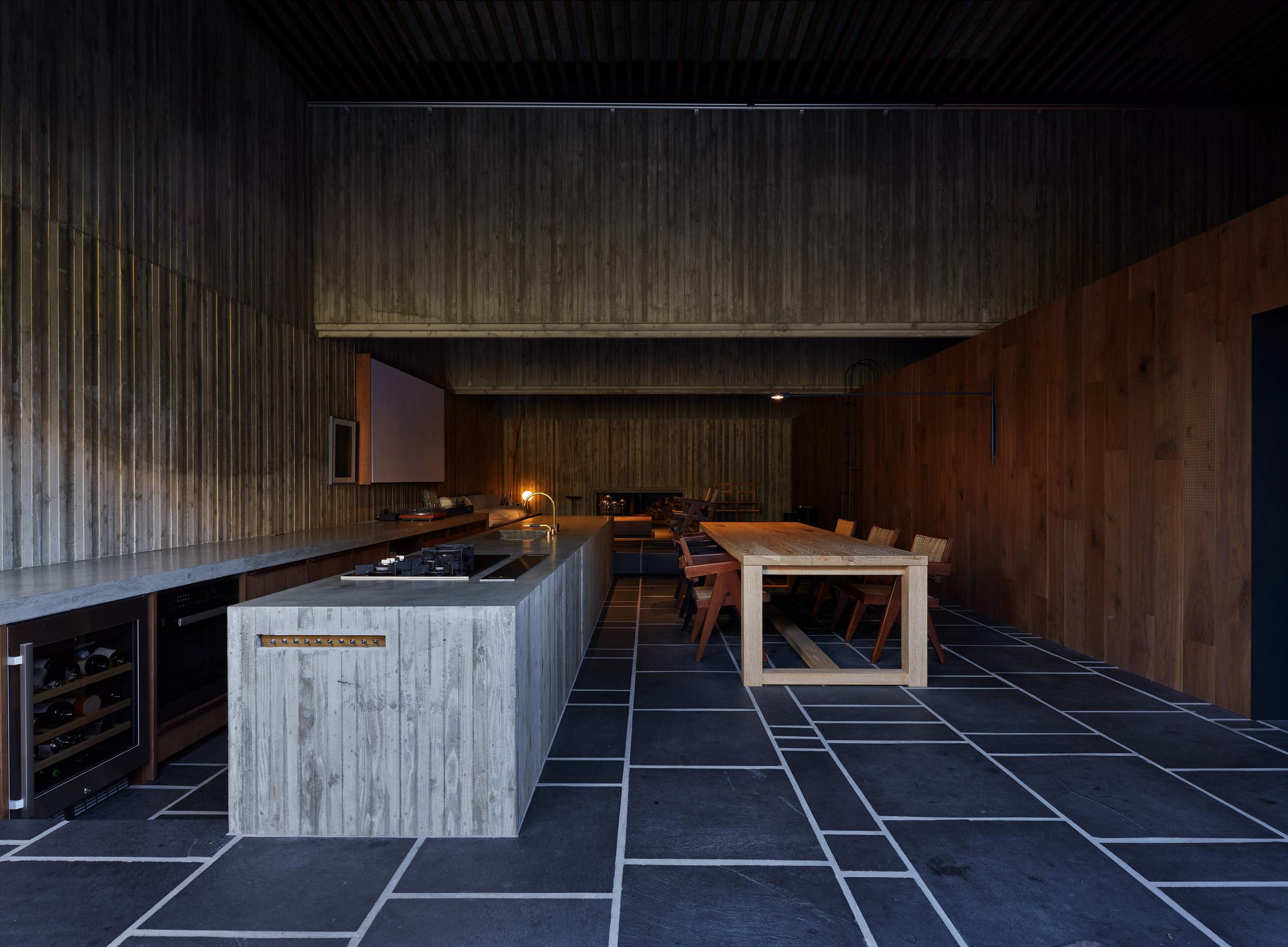 The dark concrete interiors of Japanese kitchen