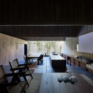 A dark living and dining room in a Japanese house