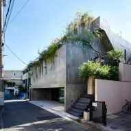 The exterior of a stepped concrete house in Japan