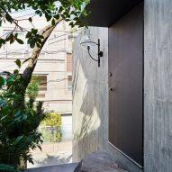 A concrete facade of a Japanese house