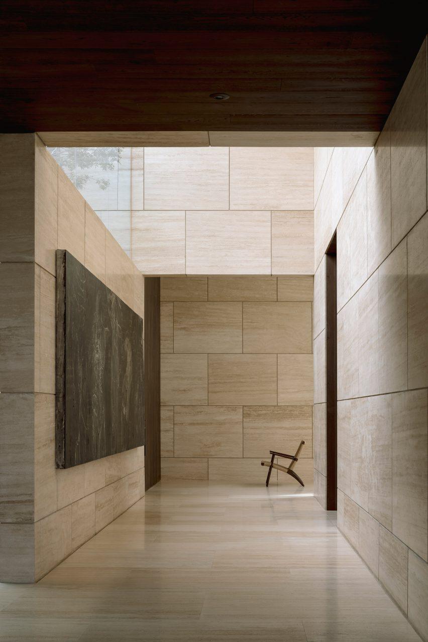 Interior corridor of marble-clad house in Mexico