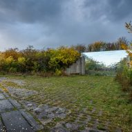 Mirrored pet crematorium at Drnov Air Defense Site by Petr Hájek Architekti