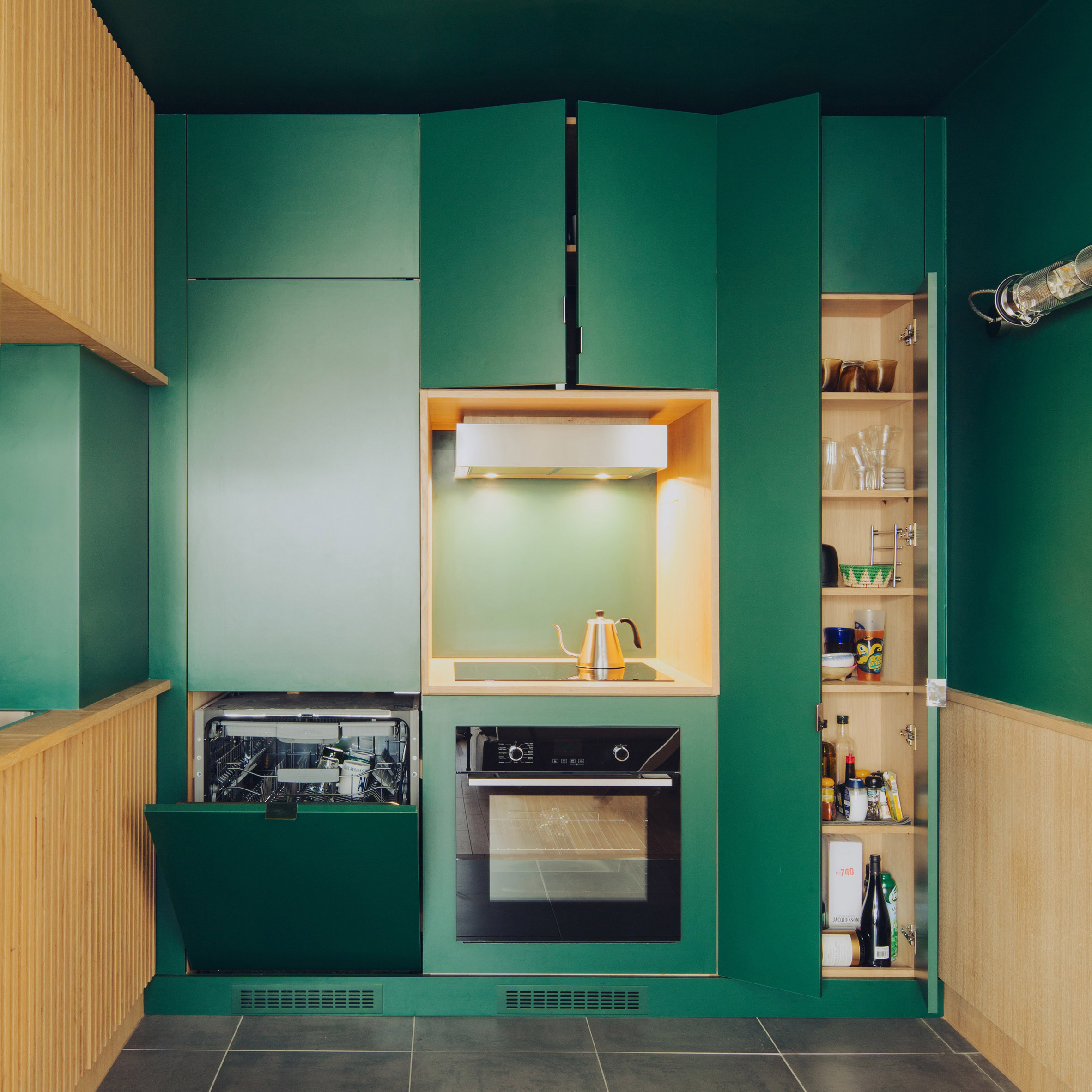 Green kitchen in Paris apartment