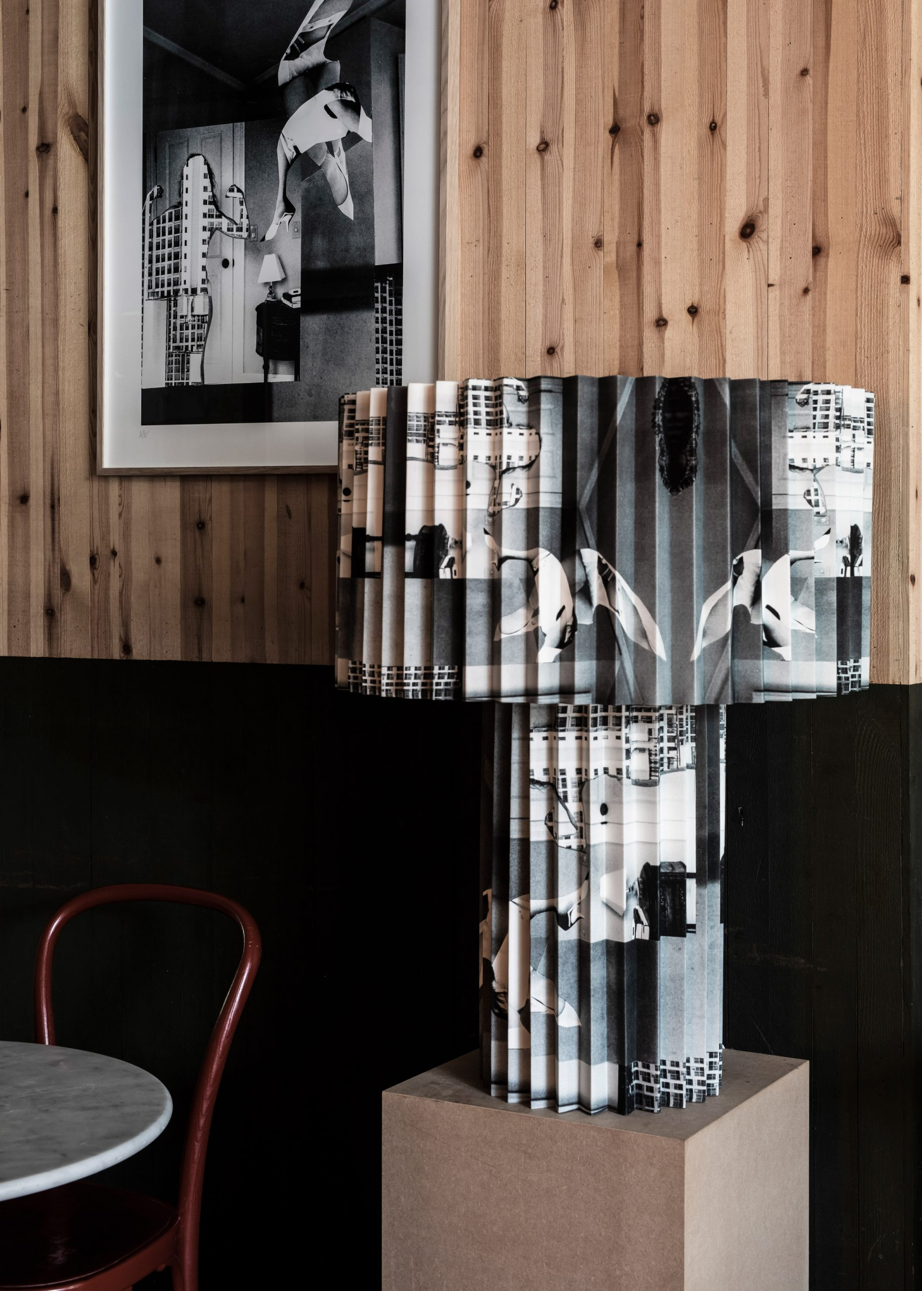 Black and white collage print on pleated lamp