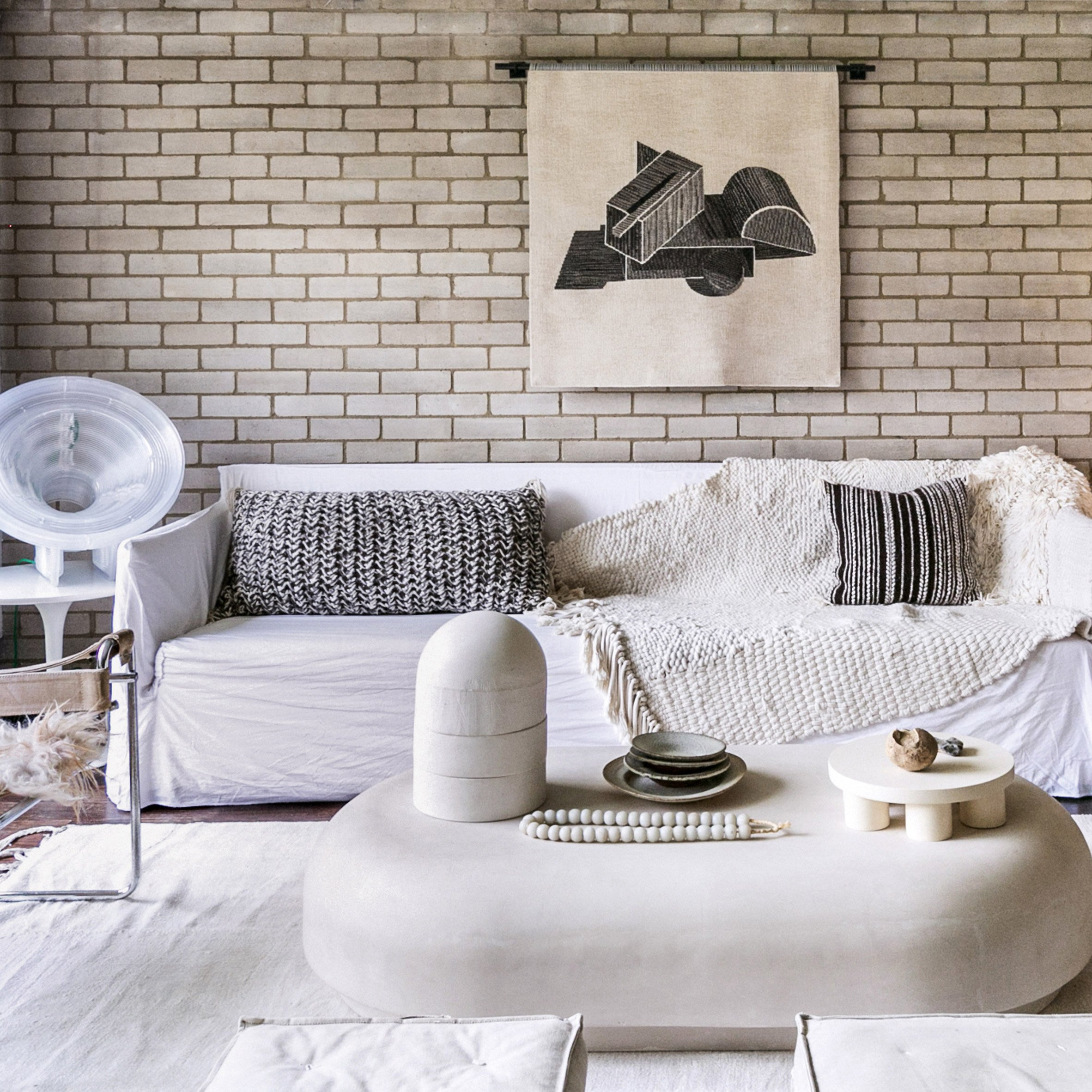 A tactile brick-walled living room