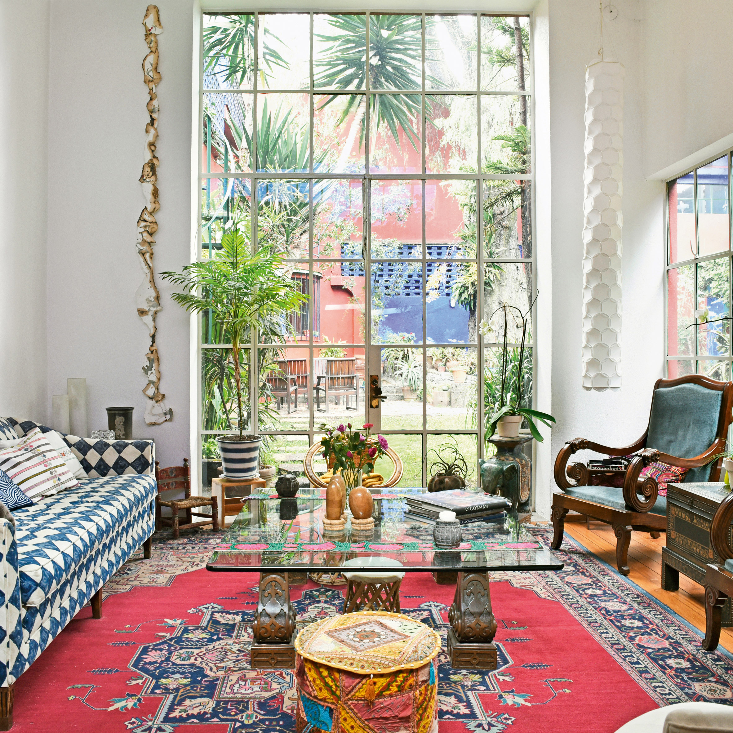 A living room with a floor-to-ceiling window
