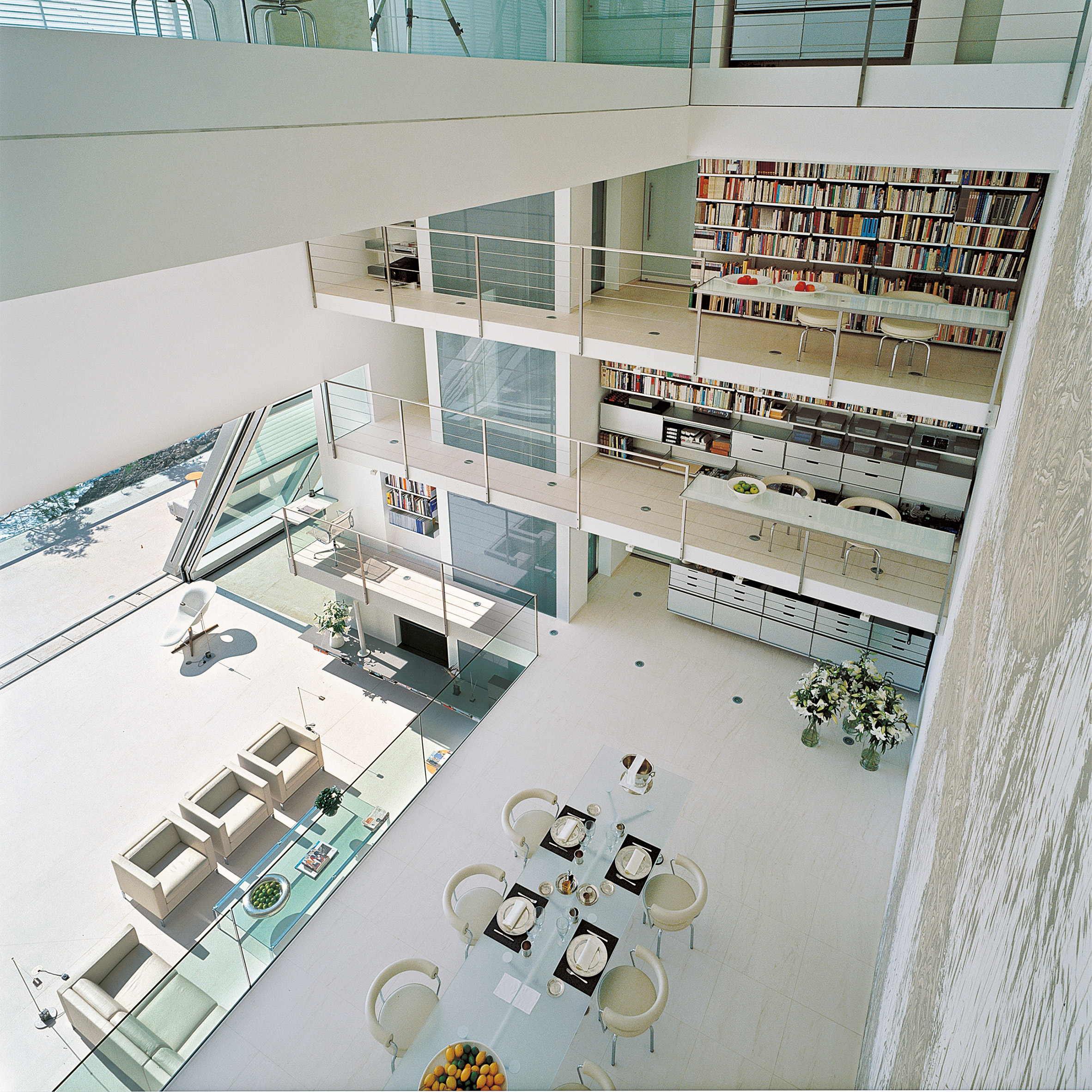 A lofty, white residential dining space