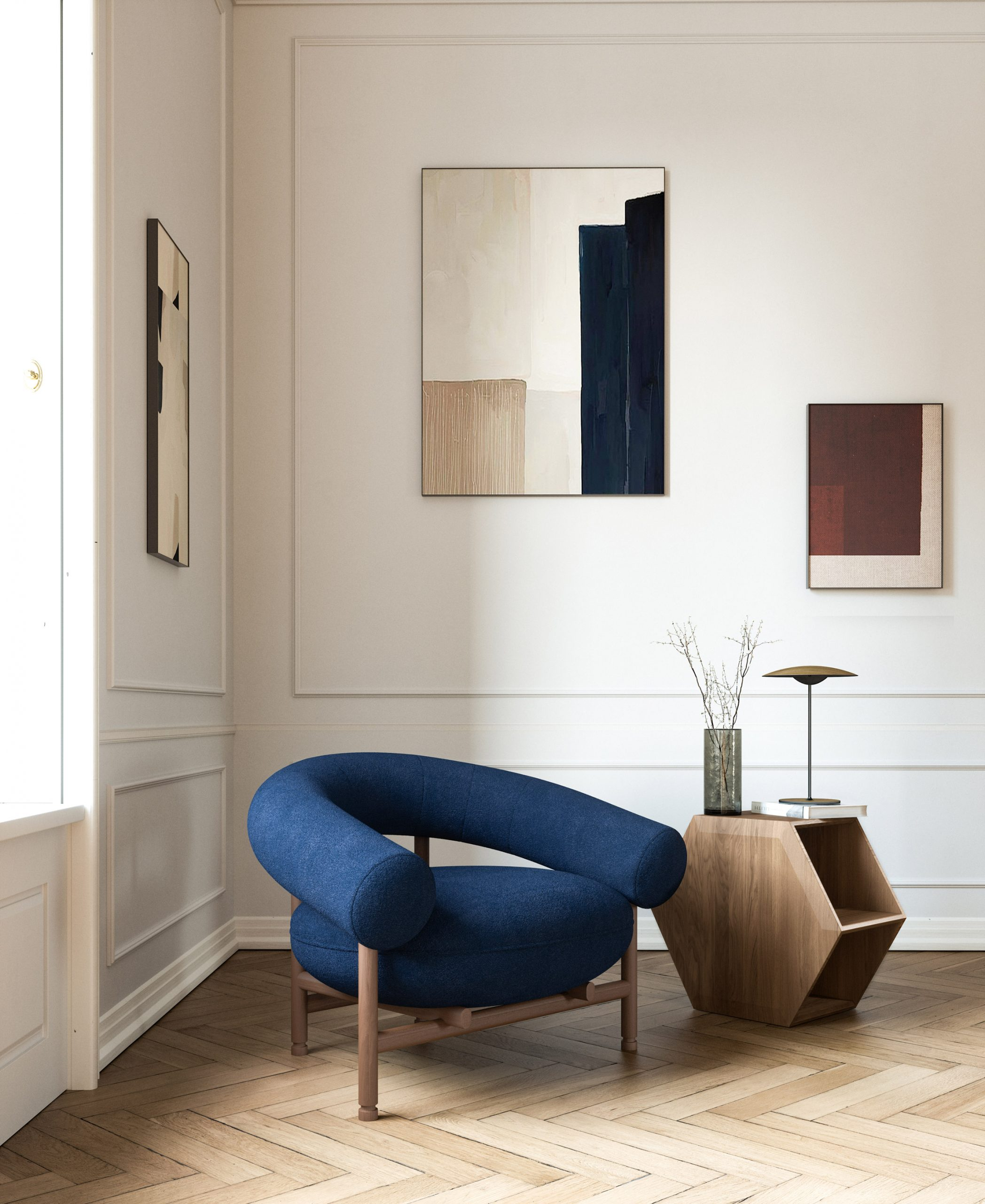 Blue upholstered chair on parquet flooring by David Girelli