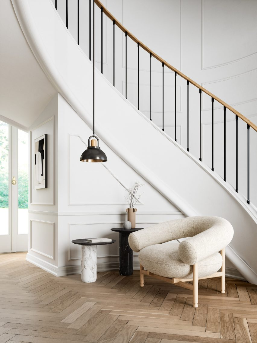 The lounge chair sits by a staircase