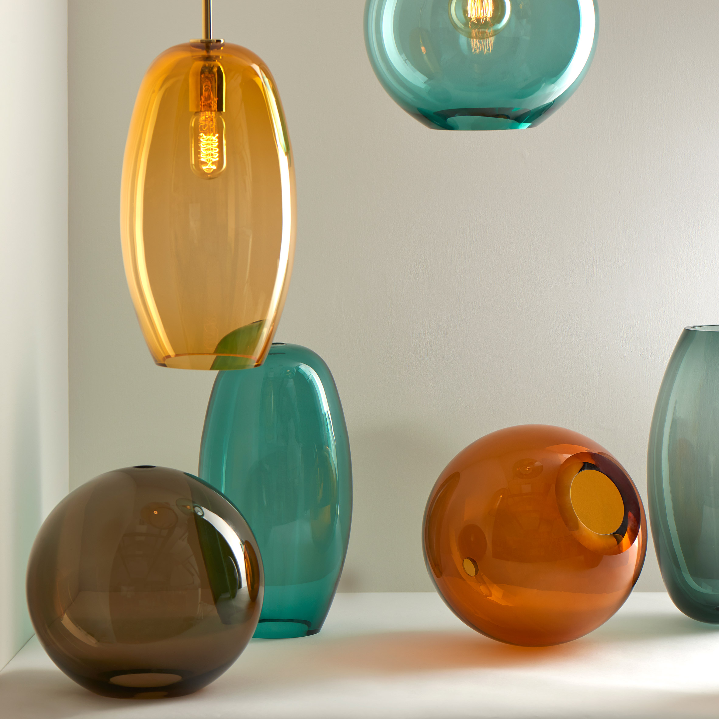Sasha and Ilona hand-blown pendant lights by Lustre