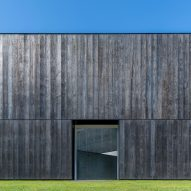 Richard Serra sculpture finds permanent home inside charred timber LX Pavilion