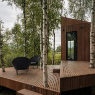 Dark wood decking outside a small cabin
